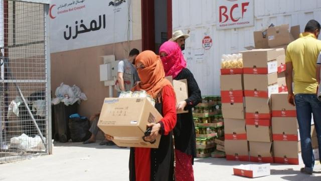 women getting aid