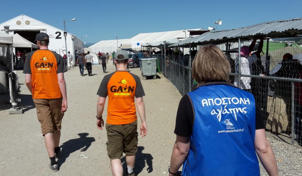 GAiN volunteers walking in camp